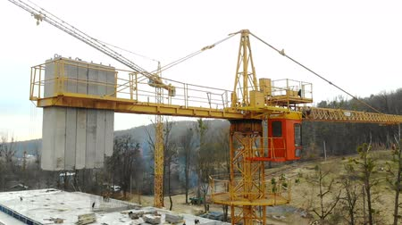 outskirts : Aerial view big construction crane, close up. Construction crane on a building background, close up. Stock Footage