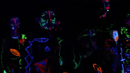 irreal : Children in neon light, girl with fluorescent make-up, Art design of female disco dancer dancing in UV light, colorful make up. Slow motion