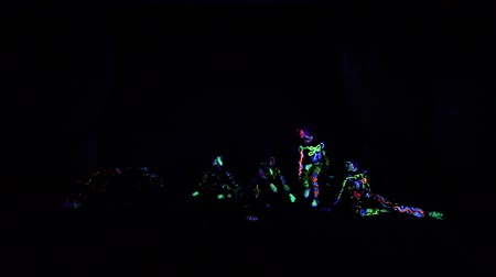 draak : Children in neon light, girl with fluorescent make-up, Art design of female disco dancer dancing in UV light, colorful make up. Slow motion