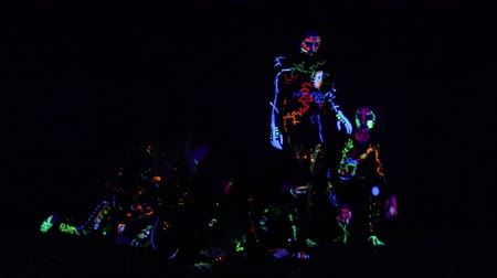 sahte : Children in neon light, girl with fluorescent make-up, Art design of female disco dancer dancing in UV light, colorful make up. Slow motion