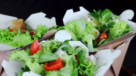 фета : Healthy diet. Salad of greens and slices of cheese tomatoes and cucumbers. Plate close-up rotates on a black background