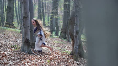 ищу : little barefoot girl runs in a forest or Park and hides behind trees in a white dress with blue patterns.