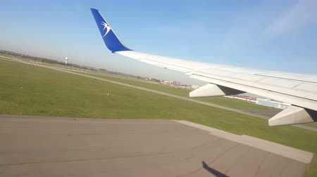warszawa : Poland. Warsaw. April 20, 2019. Plane that takes off. View through the window of the aircraft on the wing.