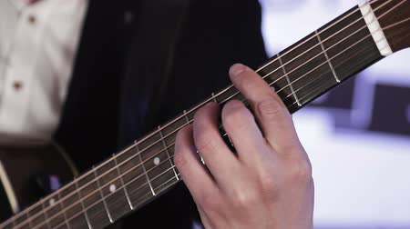 húr : Close-up of fingers that rearrange chords on acoustic guitar Stock mozgókép