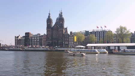 sinterklaas : Amsterdam, Netherlands. 25.04.2019. The Basilica of St. Nicholas in Amsterdam filmed from the waters of a canal. Amsterdam Netherlands. Push in shot.