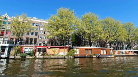 bezmotorové létání : Amsterdam, Netherlands. 25.04.2019. Restaurants located in the canals of Amsterdam. View from the tour boat. Shot with a wide angle lens
