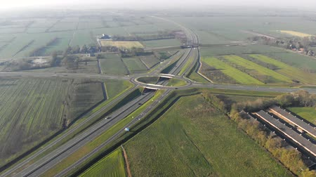 tcheco : Aerial view Flying near the highway that connects the major cities of Holland. Movement of cars on the autobahn.