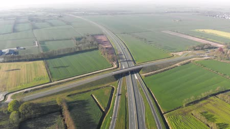 commercial cultivation : Aerial view Flying near the highway that connects the major cities of Holland. Movement of cars on the autobahn.