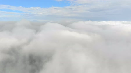 celestial : Flying through clouds. Blue sky on the background of a bunch of clouds. Clouds flying, moving heavenly sky video footage