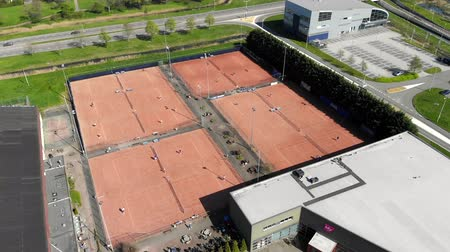служить : Aerial view tennis courts and athletes who conduct a game of tennis. Tennis courts with people who play tennis. Стоковые видеозаписи