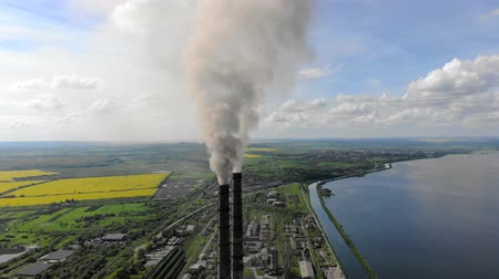 Aerial view Dense thick smoke comes from industrial pipes Against the blue sky and nature
