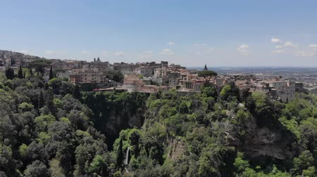 Flying over the city of Tivoli in Italy. City view from drone