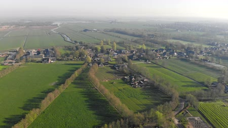 homeopático : Aerial view small beautiful village in Holland. Flying over the roofs of houses and streets of a small village in Holland. Stock Footage