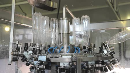 Automatic Water bottling line in plastic white bottles. Plastic bottles are sent to the line.