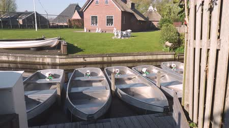 steward : A small boat station in a small village. Small boats, standing on the pier. Boats to move through the canals of Holland Stock Footage