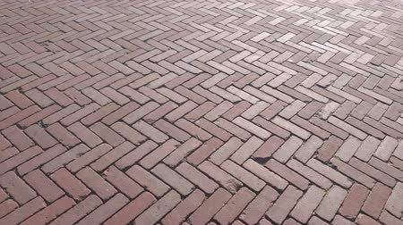 paving : The background of the famous Red pavers Holland. A method of laying paving slabs with a diamond. Park path made of stone. Stock Footage