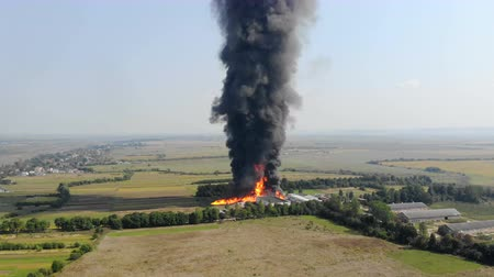 plamen : Aerial view of Huge fire view from quadcopter. Black smoke rises high into the sky. Fire on the outskirts of the city