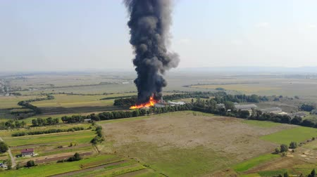 blussen : Aerial view of Huge fire view from quadcopter. Black smoke rises high into the sky. Fire on the outskirts of the city