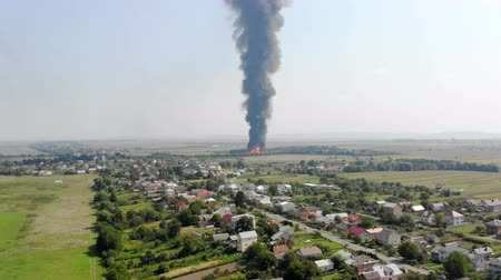extinguishing : Aerial view of Huge fire view from quadcopter. Black smoke rises high into the sky. Fire on the outskirts of the city