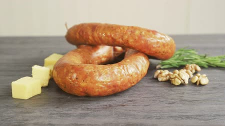 ветчина : A circle of sausage and pieces of cheese and nuts as finished products sausage factory.