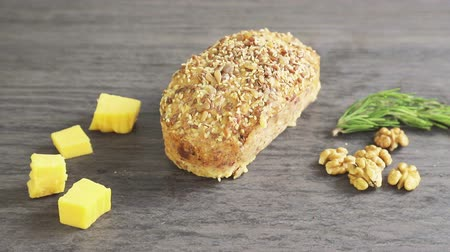 antipasti : baked bread with pieces of cheese and nuts, composition as background Stock Footage