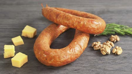 spek : A circle of sausage and pieces of cheese and nuts as finished products sausage factory.