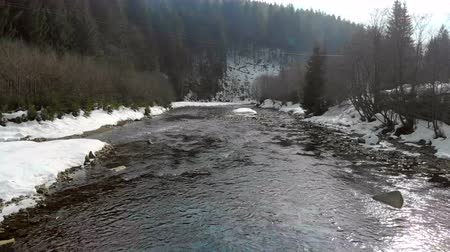 крайняя местности : Low flying over the river in the winter mountains. winter carpathian Ukraine