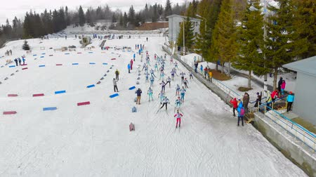 přezka : Ukraine. Yavoriv. 12 march 2019. Aerial view Biathlon in the mountains. Students participate in local competition balonu. Start the race. A group of athletes starts the race
