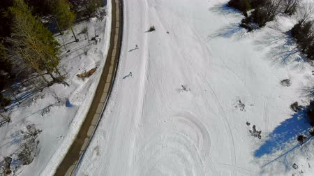 narciarz : Aerial view of Race between athletes skiers in the mountains. Biathlon in the winter mountains. A group of athletes overcomes the distance Wideo