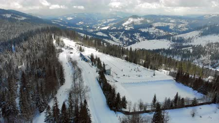 スキーヤー : Aerial view Biathlon. Winter sports in the mountains. Cross country skiing in the Ukrainian Carpathians
