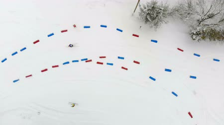 biathlon : Aerial view from the top, athletes the skiers overcome distance on skis passing by posted route from China and red chips.