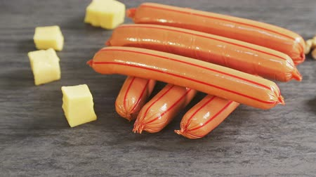 prim : Sausages or sausages lie together with slices of cheese and nuts Stok Video