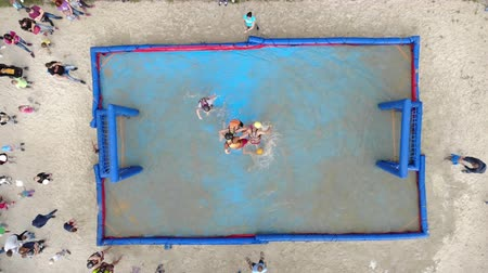 brezilya : Aerial view Playing football in an inflatable pool filled with water. Football in the water.