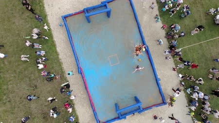 brazilian : Aerial view Playing football in an inflatable pool filled with water. Football in the water.