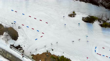 overcome : Aerial view from the top, athletes the skiers overcome distance on skis passing by posted route from China and red chips.