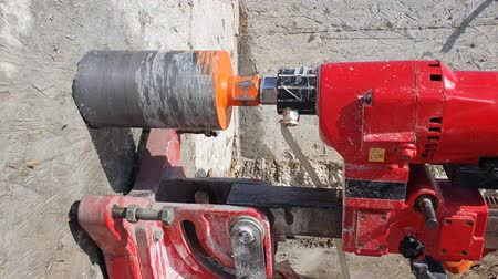 naprawa : Worker closeup drilling a large hole with a large industrial drill. Wideo