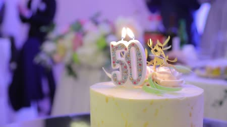 muffin : Birthday cake with the 50 year and two candles. applause on the background of the cake.
