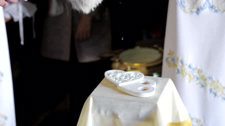 wedding and gold : the priest blesses the wedding rings in the Church with the sprinkling of Holy water. Stock Footage
