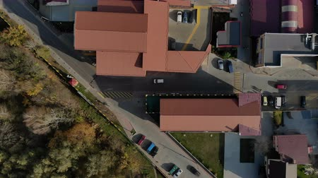 krasnodar city : Aerial Drone Flight top view at the street with houses and cars that move. Roofs of houses are red and cars that move down the street Stock Footage