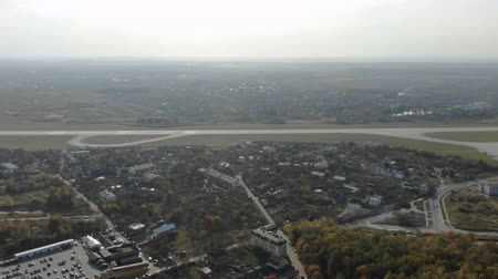 direkt : Aerial Flight at the runway. Panorama of the runway and the airport from a height.