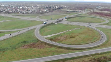 tcheco : Aerial view from road and road junctions. Entrance to the city through the ring road. Cars are moving on the road.