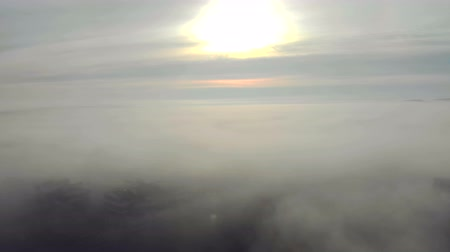 гром : Heavy fog over the city. The camera moves uphill and opens a panorama of the fog that lies over the city.