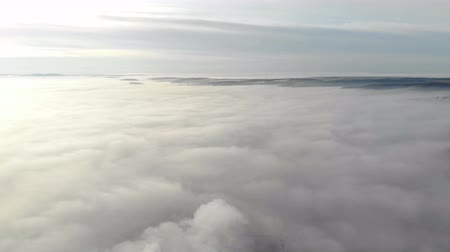 кучево дождевые облака : Heavy fog over the city. The camera moves uphill and opens a panorama of the fog that lies over the city.