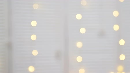 solene : Abstract blurred background of yellow and white bright circles that blink. New year Christmas background