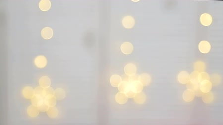 ünnepélyes : Abstract blurred background of yellow and white bright circles that blink. New year Christmas background