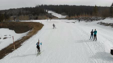 biathlon : Ukraine. Yavoriv. 04 January 2020. View from the top of a group of biathlon skiers overcoming the distance. A group of skiers, the view from the drone