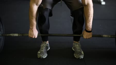 Closeup of Weightlifter lifting barbell off the ground Stok Video