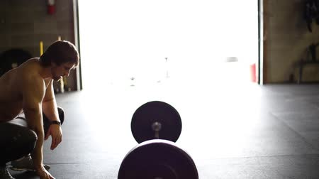 Male CrossfitterAthlete rests while breathing hard and contemplating Stok Video