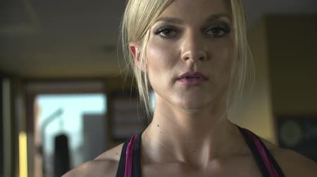 fitnes : Beautiful female athlete gives an intense look at the camera after her workout.  Great for nutritional or workout promotional videos.  Shot on Sony FS700 at 240fps.