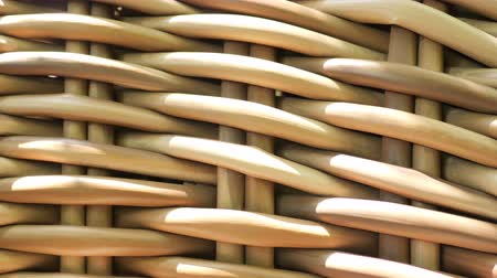 sobreposição : Shadow of bamboo trees moving on brown pattern background, artificial rattan material furniture. Close up outdoor wickerwork furniture with many dirty dust in natural daylight. Abstract and patterns concepts.